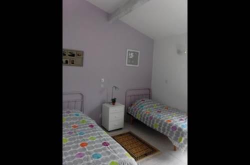 HUBERT Evelyne - Le 7 en Garrigue chambre 2 lits 1 personne © HUBERT Evelyne